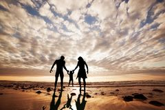 happy-family-together-hand-hand-beach-38278040